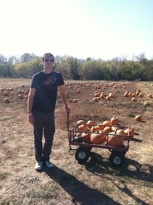 teacher man with pumpkins
