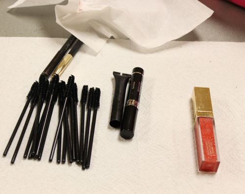 mascara wands and lip gloss backstage at fashion for a cause kansas city