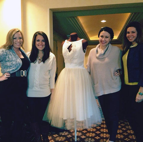 kansas city bloggers pose with a janay a handmade eco-friendly wedding dress during kansas city fashion week preview